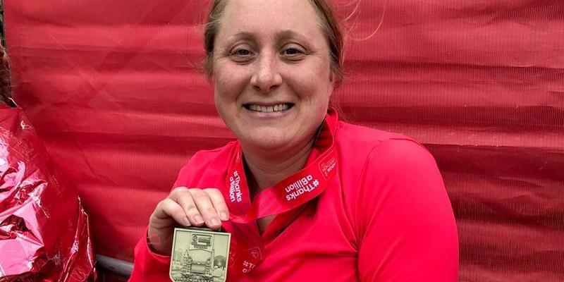 marathon runner with a medal