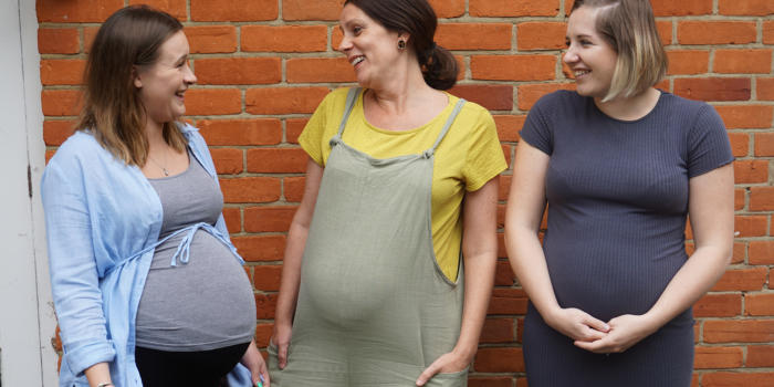 Three ladies pregnant with twins, triplets or more